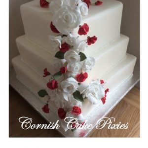 thee tier cake in white,white rose and pink sweet pea bouquet down on corner