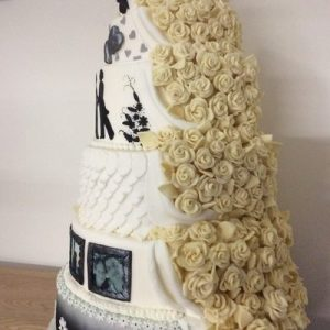6 tier wedding cake half chocolate roses half in monochrome