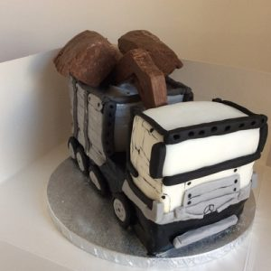 Lego Techniques sculpted truck cake with chocolate grabbers