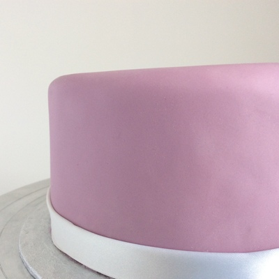 Close up of the side of a cake ,Matt purple icing