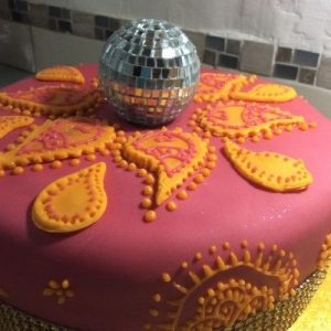 Pink and orange iced Bolliwood cake with glitter ball topper