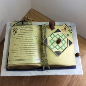 Terry Patchett Thud book cake with mini thud board and figures top view