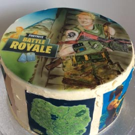 fortnite cake hand painted topper with characters from the game. printed picture from the game around the cake