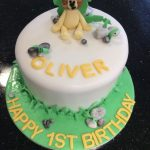 cute lion cake with name and happy 1st birthday
