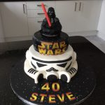 2 tier star wars cake, topped with 3D darth Vada