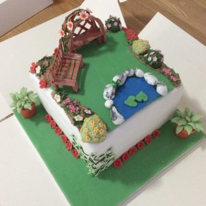 garden cake with rose arch and bench