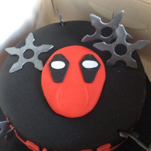 deadpool cake with mask and throwing stars
